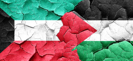 palestine: Kuwait flag with Palestine flag on a grunge cracked wall Stock Photo