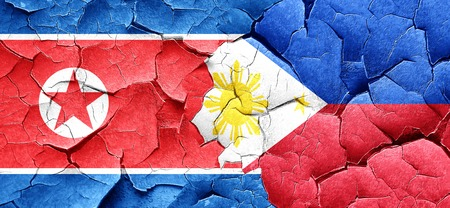 philippino: North Korea flag with Philippines flag on a grunge cracked wall Stock Photo
