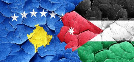 cracked wall: Kosovo flag with Jordan flag on a grunge cracked wall