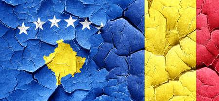 romania flag: Kosovo flag with Romania flag on a grunge cracked wall Stock Photo