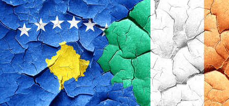 cracked wall: Kosovo flag with Ireland flag on a grunge cracked wall Stock Photo