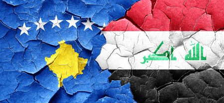 iraq war: Kosovo flag with Iraq flag on a grunge cracked wall Stock Photo