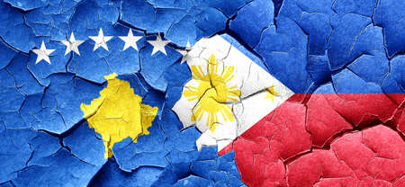 kosovo: Kosovo flag with Philippines flag on a grunge cracked wall