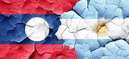 argentine: Laos flag with Argentine flag on a grunge cracked wall