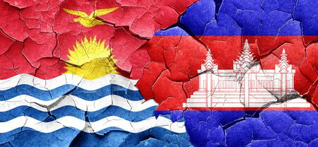 cambodian flag: Kiribati flag with Cambodia flag on a grunge cracked wall