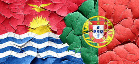 portugese: Kiribati flag with Portugal flag on a grunge cracked wall Stock Photo