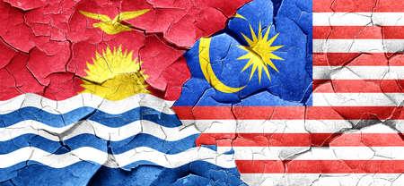 kiribati: Kiribati flag with Malaysia flag on a grunge cracked wall