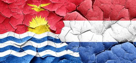 netherlands flag: Kiribati flag with Netherlands flag on a grunge cracked wall