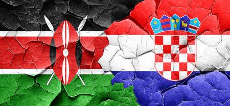 bandera croacia: bandera de Kenia con la bandera de Croacia en una pared agrietada grunge