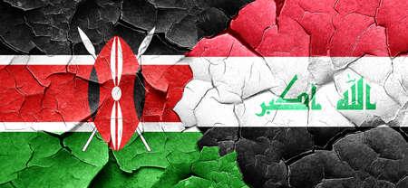 iraq war: Kenya flag with Iraq flag on a grunge cracked wall