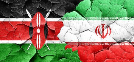 cracked wall: Kenya flag with Iran flag on a grunge cracked wall