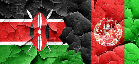 Kenya flag with afghanistan flag on a grunge cracked wall Stock Photo