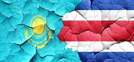 rican: Kazakhstan flag with Costa Rica flag on a grunge cracked wall