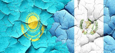 bandera de guatemala: bandera de Kazajist�n con la bandera de Guatemala en una pared agrietada grunge