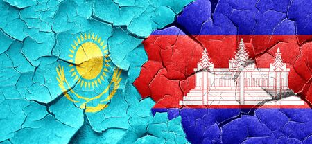 cambodian: Kazakhstan flag with Cambodia flag on a grunge cracked wall