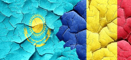 romania flag: Kazakhstan flag with Romania flag on a grunge cracked wall