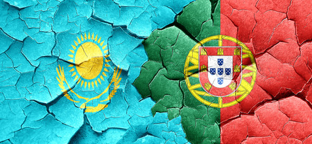 cracked wall: Kazakhstan flag with Portugal flag on a grunge cracked wall Stock Photo