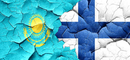 FINLAND flag: Kazakhstan flag with Finland flag on a grunge cracked wall