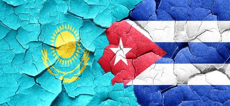 cuba flag: Kazakhstan flag with cuba flag on a grunge cracked wall Stock Photo