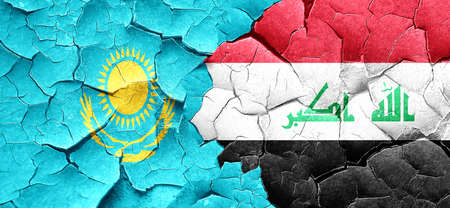 iraq conflict: Kazakhstan flag with Iraq flag on a grunge cracked wall