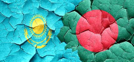 bangladesh: Kazakhstan flag with Bangladesh flag on a grunge cracked wall
