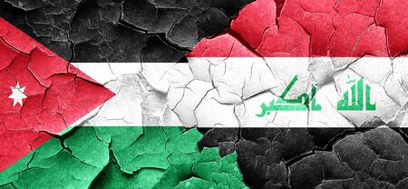 iraq conflict: Jordan flag with Iraq flag on a grunge cracked wall