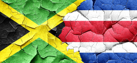 rican: Jamaica flag with Costa Rica flag on a grunge cracked wall