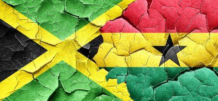 ghanese: Jamaica flag with Ghana flag on a grunge cracked wall
