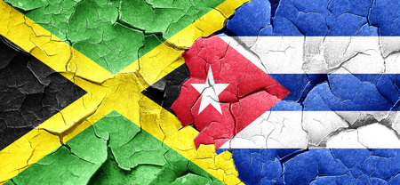 flag of cuba: Jamaica flag with cuba flag on a grunge cracked wall