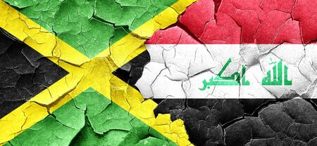 iraq conflict: Jamaica flag with Iraq flag on a grunge cracked wall
