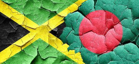 bangladesh: Jamaica flag with Bangladesh flag on a grunge cracked wall
