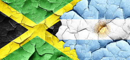 argentine: Jamaica flag with Argentine flag on a grunge cracked wall