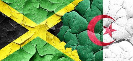 jamaican: Jamaica flag with Algeria flag on a grunge cracked wall Stock Photo