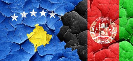 afghanistan flag: Kosovo flag with afghanistan flag on a grunge cracked wall