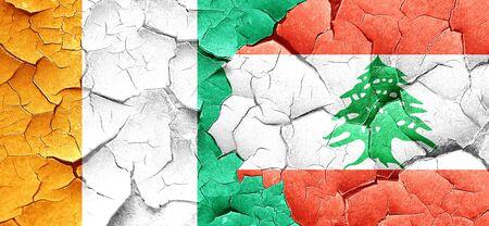 ivory: Ivory coast flag with Lebanon flag on a grunge cracked wall Stock Photo