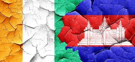 cambodian: Ivory coast flag with Cambodia flag on a grunge cracked wall Stock Photo