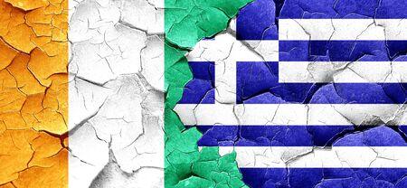 grunge flag: Ivory coast flag with Greece flag on a grunge cracked wall