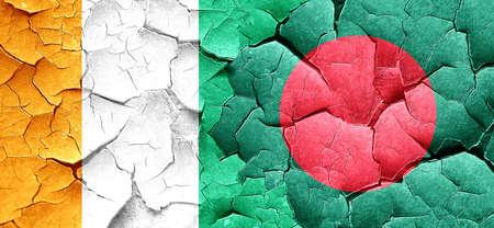 bangladesh: Ivory coast flag with Bangladesh flag on a grunge cracked wall