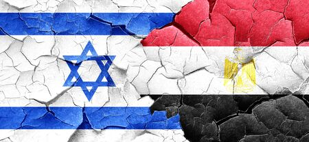 egypt flag: Israel flag with egypt flag on a grunge cracked wall Stock Photo
