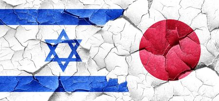 cracked wall: Israel flag with Japan flag on a grunge cracked wall Stock Photo