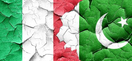 pakistan flag: Italy flag with Pakistan flag on a grunge cracked wall