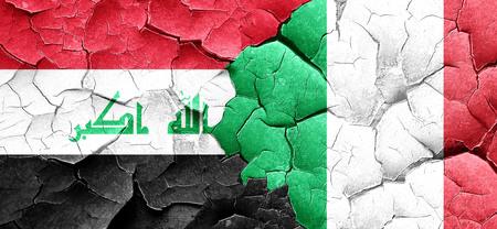 italian politics: Iraq flag with Italy flag on a grunge cracked wall