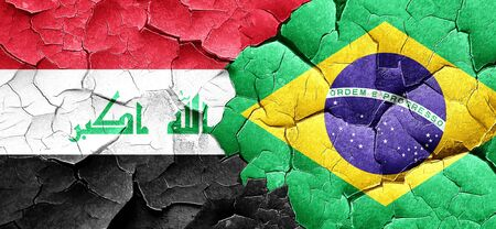 cracked wall: Iraq flag with Brazil flag on a grunge cracked wall Stock Photo