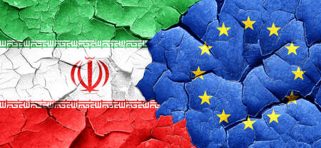 against: iran flag with european union flag on a grunge cracked wall