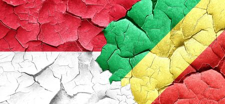 congo: Indonesia flag with congo flag on a grunge cracked wall