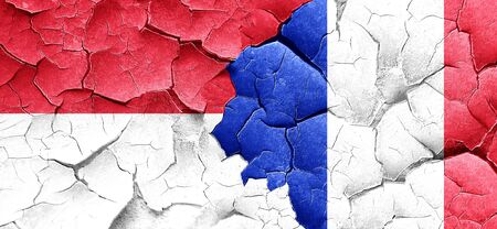 cracked wall: Indonesia flag with France flag on a grunge cracked wall