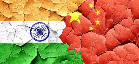 cracked wall: India flag with China flag on a grunge cracked wall