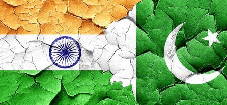 pakistan flag: India flag with Pakistan flag on a grunge cracked wall Stock Photo