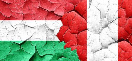 bandera de peru: bandera de Hungría con la bandera de Perú en una pared agrietada grunge Foto de archivo