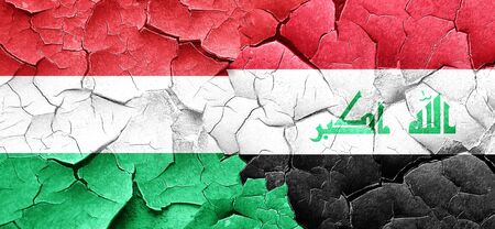 iraq conflict: Hungary flag with Iraq flag on a grunge cracked wall Stock Photo